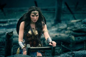 A Supermodel Cosplays as Wonder Woman on a ladder