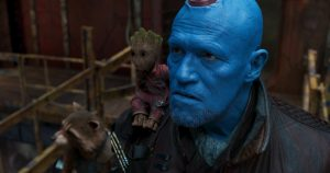 Yondu and Baby Groot with a trash panda in the background