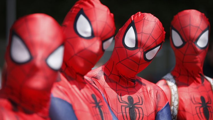 four spider cosplayers